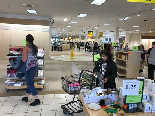 Bargain shoppers found discounted items, some tables with everything on sale for a quarter, last week at Herberger's in Great Falls. The store closed closed last Wednesday.