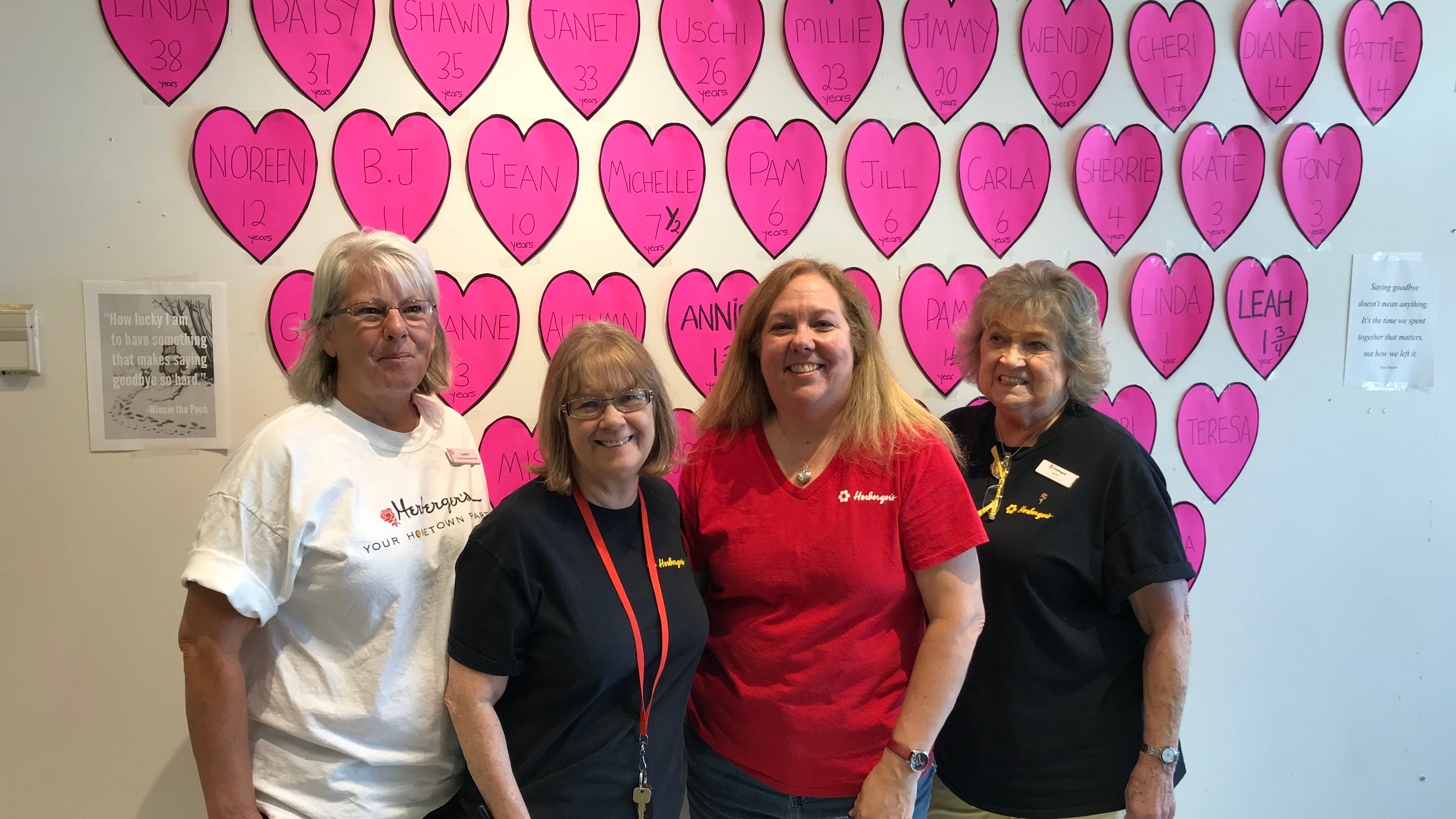 Longtime Herberger's employees, from left, Lynda Reeve, Patsy Lindberg, Shawn Dixon and Janet Otter posed for a photograph before the business closed for good last Wednesday.