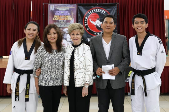 "Master Noly Caluag chief instructor of Guam Taekwondo Center is joined by his daughter, Michelle Caluag, wife Malu Caluag, Congresswoman Madeleine  Bordallo, and Joseph ""Jed"" Caluag.  Bordallo was the keynote speaker during the 2018 Master Noly's Super Taekwondo Tournament held August 26 at Micronesia Mall to celebrate the 16th anniversary of Guam Taekwondo Center."