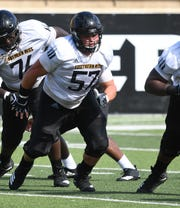 Southern Miss center Trace Clopton runs a set of drills during practice in M.M. Roberts Stadium on Tuesday, August 28, 2018.