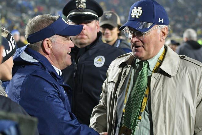 Jack Swarbrick (right) has stuck by Brian Kelly in some tumultuous times.