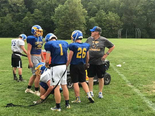 Randy Minniear (right) at Brown County football practice earlier this week.