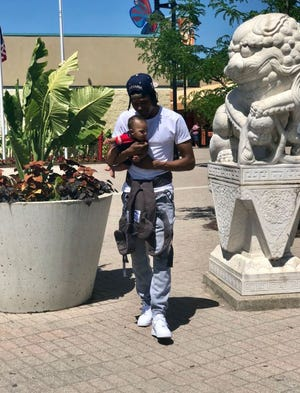 JaQuon Dean holds his son