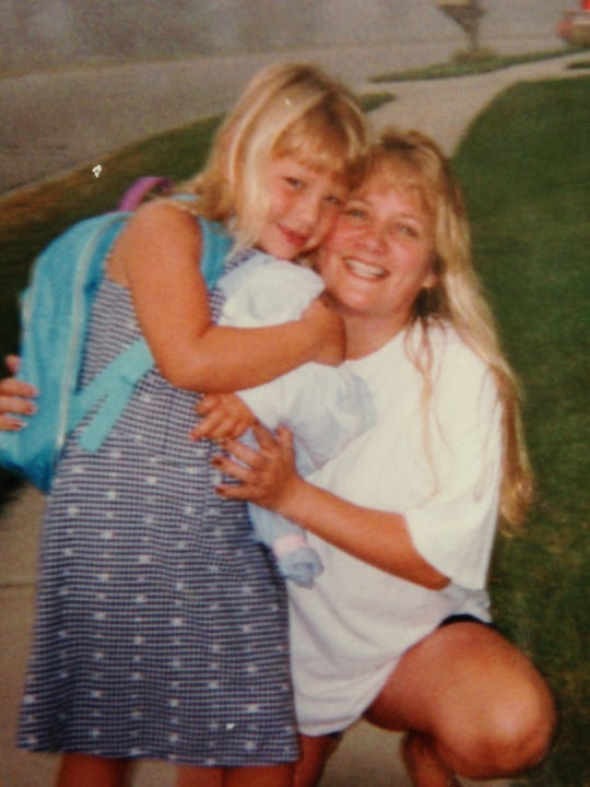 Rachael Heffner smiles with her mom, Kim Heffner, in this undated photo. Kim was diagnosed with a rare disease before dying in 1998, when Rachael was seven.