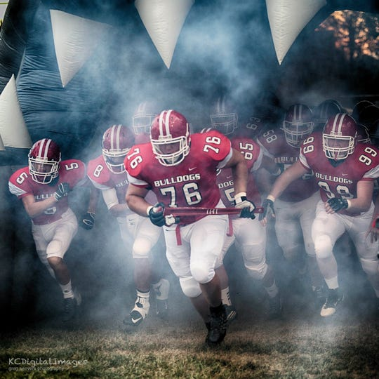 Wes Martin (76) leads out the Milton-Union team during his prep career in Ohio.