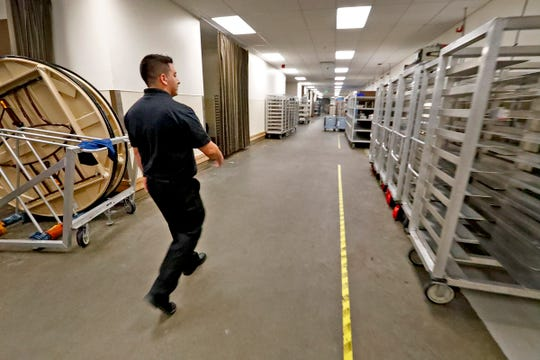 Pablo Perez walks through the back of the JW Marriott where he works, Thursday, Aug. 30, 2018.  Perez is the  manager for stewarding at the JW Marriott, supervising a team of employees who work with on-site luncheons, keep the kitchens clean, wash the dishes, as well as other duties.  He is one of ten people in the U.S. who received the Cintas 2018 Everyday Impact Hero Award.  He received the award for his hard work at work and at home.  At 21, he is the primary breadwinner for his family, including for his brother and sister, and for his grandmother.  And he is the guardian of his younger siblings, since his parents have passed away.   At the JW Marriott, he worked up to manager in just three years.