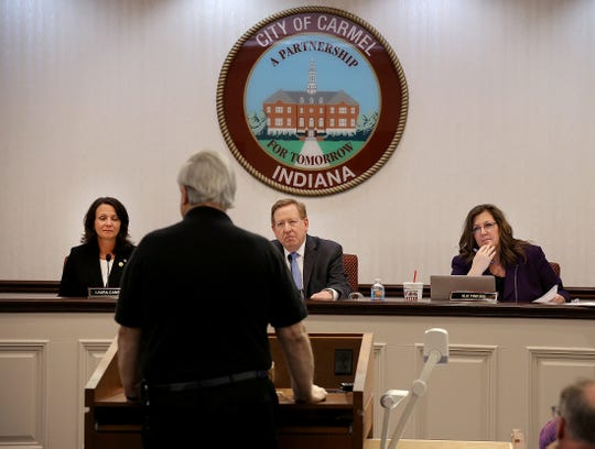Carmel City Council members Laura Campbell, left, Sue Finkam,right, and Mayor Jim Brainard, center, listen as a Carmel citizen addresses the council on Jan. 4, 2016.