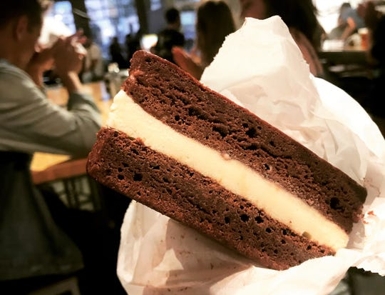 Dark chocolate brownies sandwich Tahitian vanilla ice cream at Red Flag Comedy's Ice Cream Social Open Mic in Fletcher Place. The next event is Sept. 26, 2018, next door to Dugout Bar.