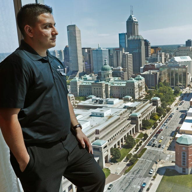 Pablo Perez shows the downtown skyline from a top floor at the JW Marriott, Thursday, Aug. 30, 2018.  Perez is the  manager for stewarding at the JW Marriott, supervising a team of employees who work with on-site luncheons, as well as other duties.  He is one of ten people in the U.S. who received the Cintas 2018 Everyday Impact Hero Award.  He received the award for his hard work at work and at home.  At 21, he is the primary breadwinner for his family, including for his brother and sister, and for his grandmother.  And he is the guardian of his younger siblings, since his parents have passed away.   At the JW Marriott, he worked up to manager in just three years.