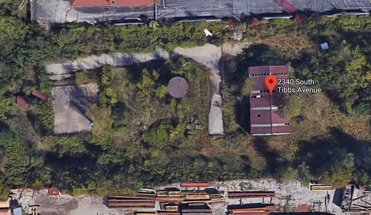 An aerial view of the former A&A Oil site on Indianapolis' southwest side, where a building and some above-ground storage tanks can be seen. This site is currently the subject of an EPA cleanup that began Wednesday due to hazardous waste contamination at the site.