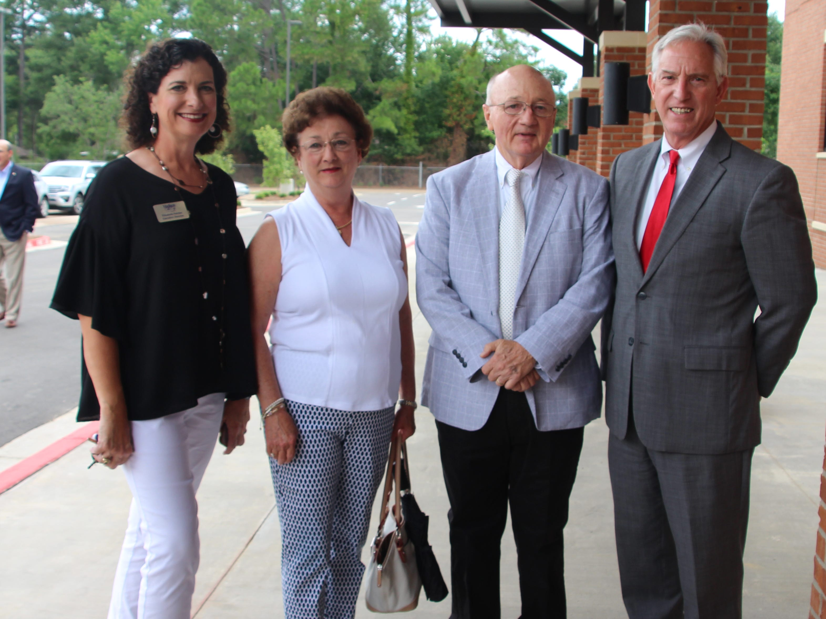 Madison the City Chamber of Commerce Exec. Dirc. Elizabeth Fulcher, from left, MRA grandparent and former faculty member Paula Thompson, former Head of School Tommy Thompson and Head of School Termie Land were all on hand for the ceremony.