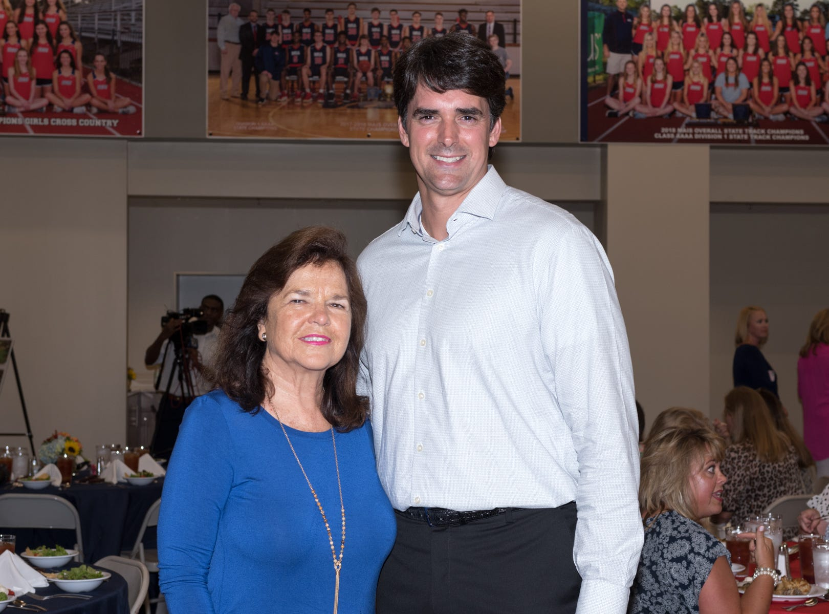 Madison Alderman and former MRA Principal Pat Peele, left, and Brad Gatlin, MRA alumnus and Board of Trustees member, attended the event.