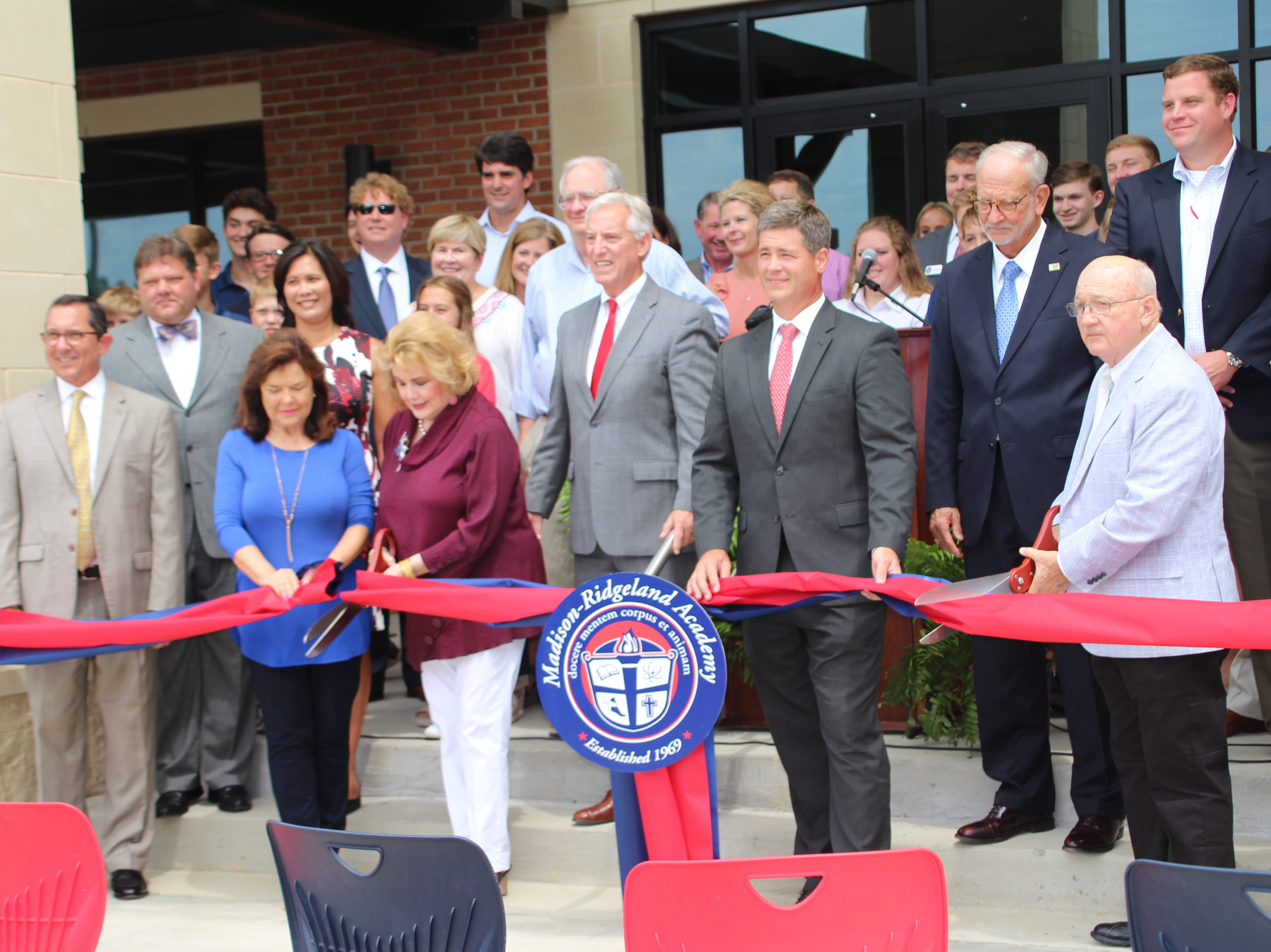 The ribbon is cut to the new MRA Middle School.