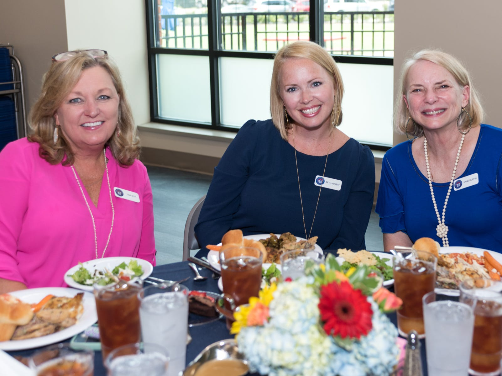 Staff members, from left, Tina Box and Beth Murray and faculty member Ann Ruffin share their meal together. Murray is a MRA alumna and Ruffin has a grandchild at the school.