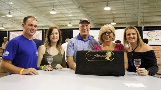Attendees Brandon Westbrook, Kelsey Douglas, Bill Beiter, Barbra Beiter and Lena Beal stop for a photo July 28, 2018, during the annual Toast of Jackson at Jackson Fairgrounds Park in Downtown Jackson.