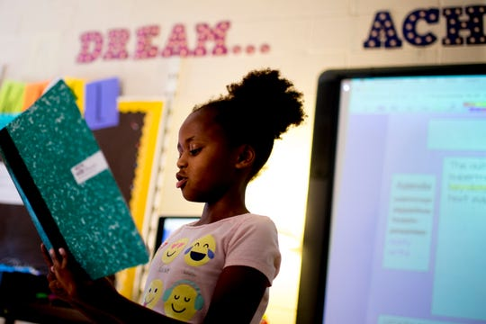 "Third-grader Anna H. reads her ""quick write"" reading comprehension exercise in front of her class at Blue Grass Elementary School in West Knoxville, Tennessee on Wednesday, August 29, 2018. Forty percent of third graders in Knox County Schools are reading at grade level as literacy continues to be a top priority for the school district and Superintendent Bob Thomas."