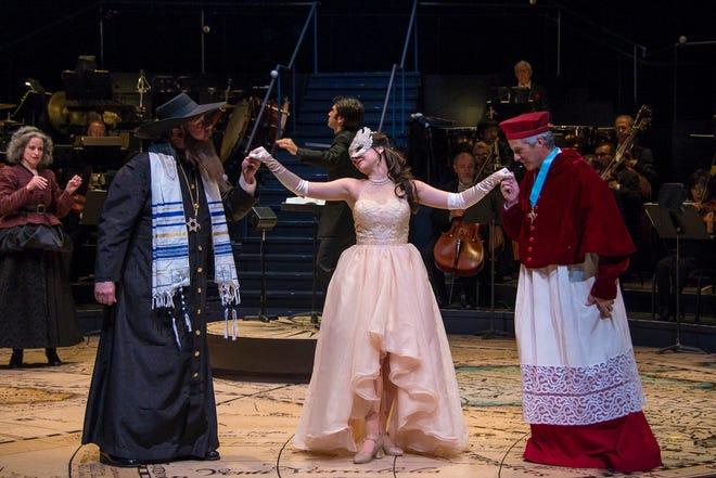 "Cunegonde, played by Cecilia Iole, is partnered by Roderick Peeples, left, and Jeff Parker, right in the Clarence Brown Theatre-Knoxville Symphony Orchestra production of ""Candide."""