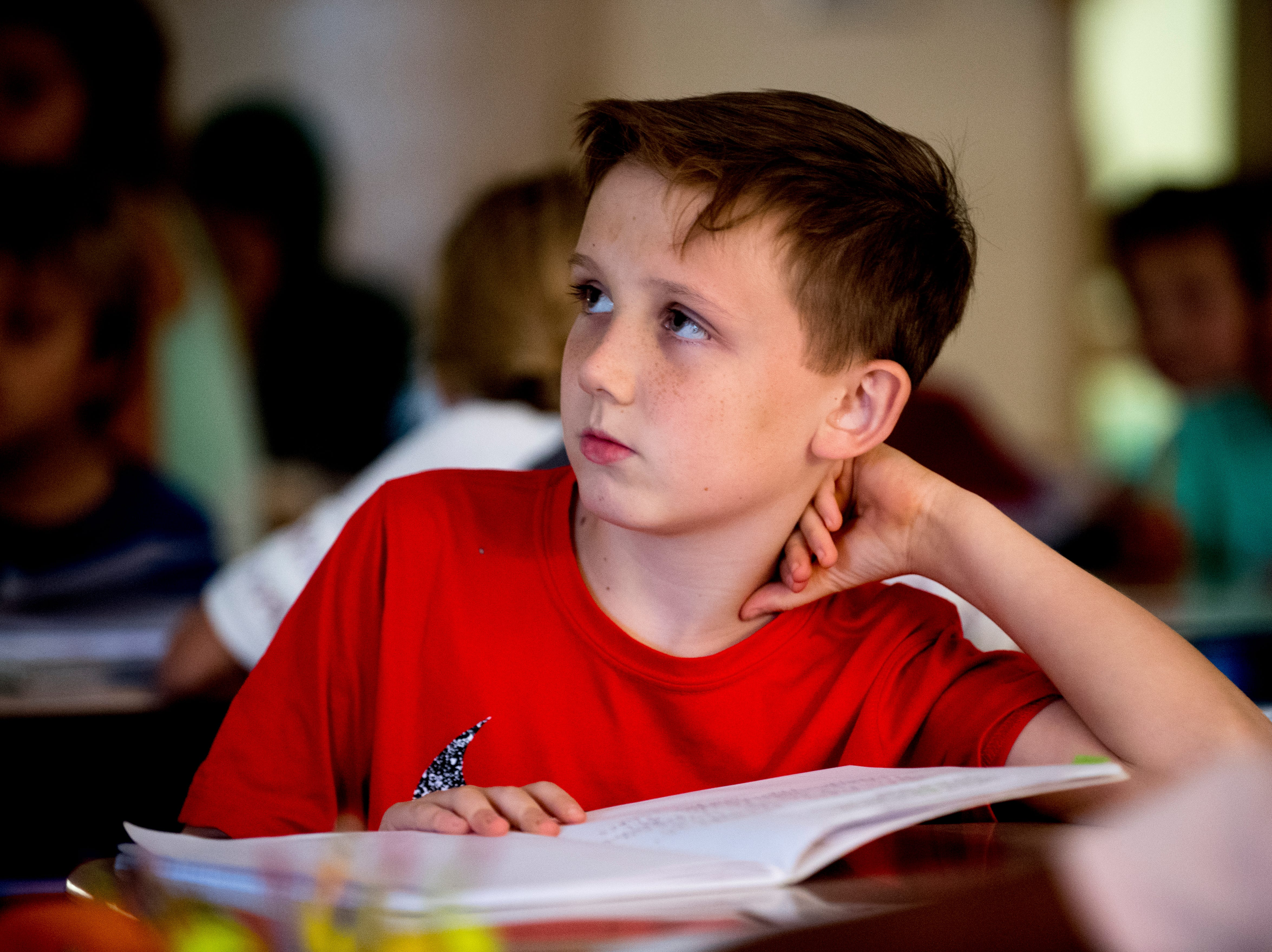 Third-grader Max M. listens as his teacher Nikki Sawyers at Blue Grass Elementary School in West Knoxville, Tennessee on Wednesday, August 29, 2018. Forty percent of third graders in Knox County Schools are reading at grade level as literacy continues to be a top priority for the school district and Superintendent Bob Thomas.