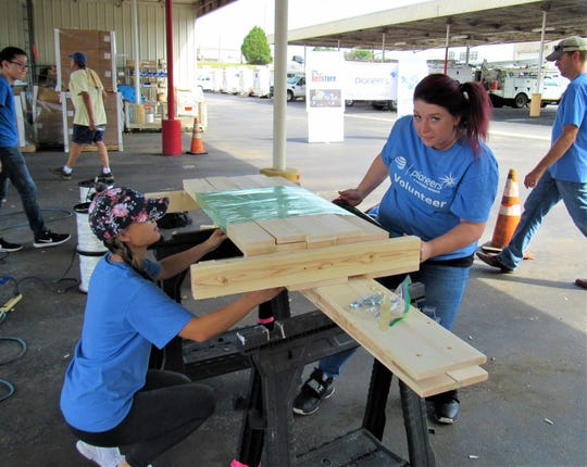 Carrie Tester and Nikki Skinner traveled from Johnson City to lend a hand at the AT&T Pioneers' Build a Bed project. Skinner is vice president of the Tennessee chapter of Pioneers. Aug. 25, 2018