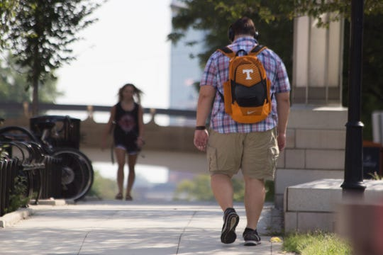A Volunteers fan walks down Cumberland Avenue on Thursday near campus.