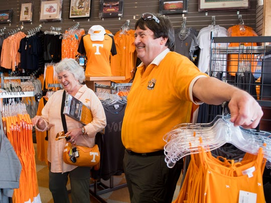 Denise Kinney and Gary Kinney share a laugh as they talk about their Vols fandom at HoundDogs of Knoxville on Wednesday, August 29, 2018.