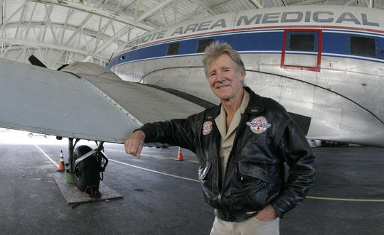 Remote Area Medical director Stan Brock stands with a 1944 DC3 airplane in Knoxville on Nov. 13, 2009. Remote Area Medical is a nonprofit organization whose volunteers offer free health care to the uninsured, the underinsured and the desperate.