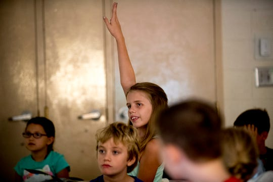 Third-grader Abby G. raises her hand during a lesson in Nikki Sawyers' class at Blue Grass Elementary School in West Knoxville, Tennessee on Wednesday, August 29, 2018. Forty percent of third graders in Knox County Schools are reading at grade level as literacy continues to be a top priority for the school district and Superintendent Bob Thomas.