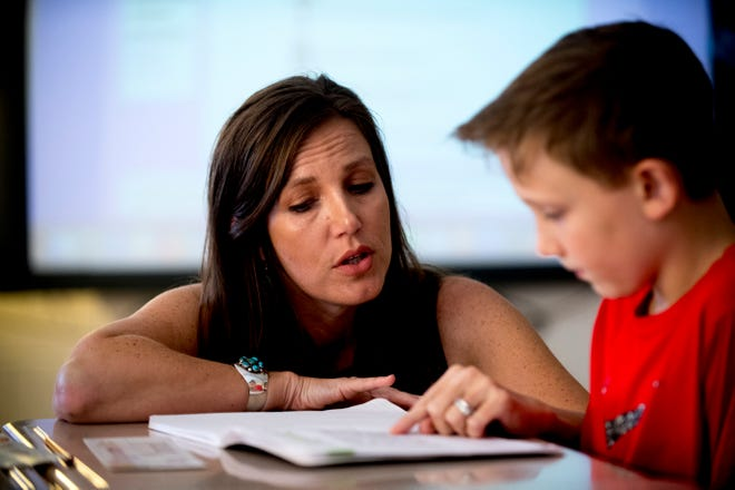 """Third-grade teacher Nikki Sawyers helps Max M. with his """"quick write"""" reading comprehension exercise at Blue Grass Elementary School in West Knoxville, Tennessee on Wednesday, August 29, 2018. Forty percent of third graders in Knox County Schools are reading at grade level as literacy continues to be a top priority for the school district and Superintendent Bob Thomas."""