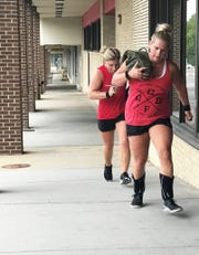Renee Graves and Christy Kooch do a strength-building run at Red Devil CrossFit.