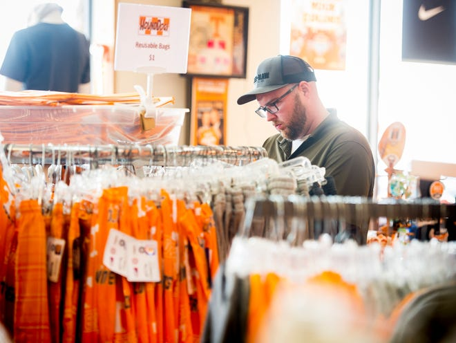 Customers browse through Vols-themed clothing at HoundDogs of Knoxville on Wednesday, August 29, 2018.