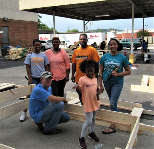 Working together, Ayanna Albright, Monica Smith-Albright, Anthony Albright, Caidyn Crawford, Jay Foster and Alonna Albright were part of the team that volunteered for the Build-a-Bed project. Aug. 25, 2018