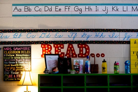Posters and artwork hang on the wall in the back of Nikki Sawyers' classroom at Blue Grass Elementary School in West Knoxville, Tennessee on Wednesday, August 29, 2018. Forty percent of third graders in Knox County Schools are reading at grade level as literacy continues to be a top priority for the school district and Superintendent Bob Thomas.