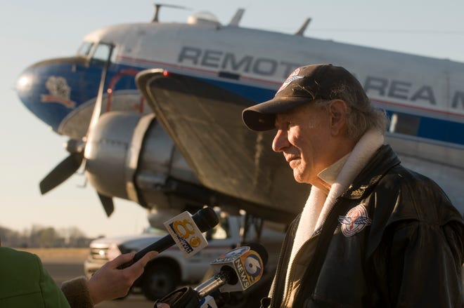Remote Area Medical founder Stan Brock talks with reporters as supplies for Haitian earthquake victims are loaded onto a DC-3 Friday, January 15, 2010 at McGhee Tyson Airport. Brock will be at the controls of the plane (with co-pilot Jim Massengill) as over 2,000 pounds of supplies donated by area residents are delivered to the earthquake zone.