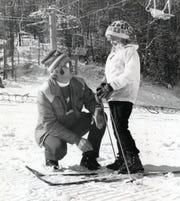 Rolf Lanz with Ginna Hendry, 8, at Gatlinburg Ski Resort in 1974.