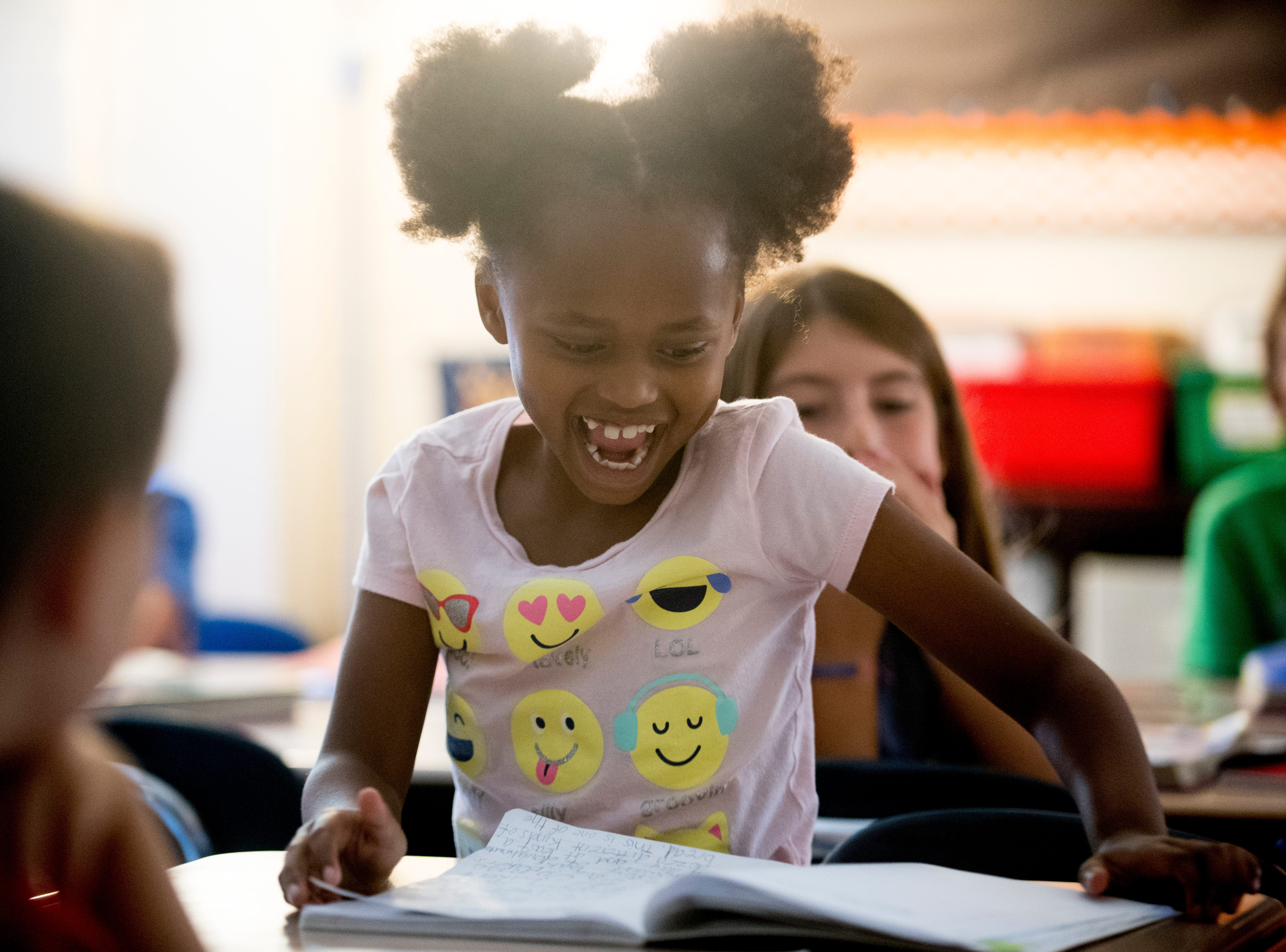 "Third-grader Anna H. reacts with excitement after being chosen to read her ""quick write"" reading comprehension exercise in front of her class at Blue Grass Elementary School in West Knoxville, Tennessee on Wednesday, August 29, 2018. Forty percent of third graders in Knox County Schools are reading at grade level as literacy continues to be a top priority for the school district and Superintendent Bob Thomas."