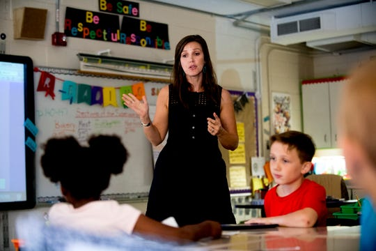 Third grade teacher Nikki Sawyers guides her students through a lesson at Blue Grass Elementary School in West Knoxville, Tennessee on Wednesday, August 29, 2018. Forty percent of third graders in Knox County Schools are reading at grade level as literacy continues to be a top priority for the school district and Superintendent Bob Thomas.