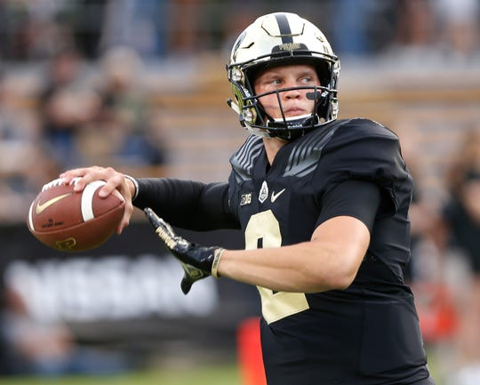 Quarterback Elijah Sindelar warms up before Purdue takes on Northwestern Thursday, August 30, 2018, in West Lafayette.