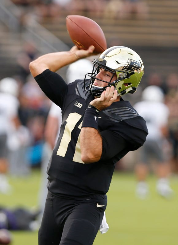 Quarterback David Blough warms up before Purdue face Northwestern Thursday, August 30, 2018, in West Lafayette.
