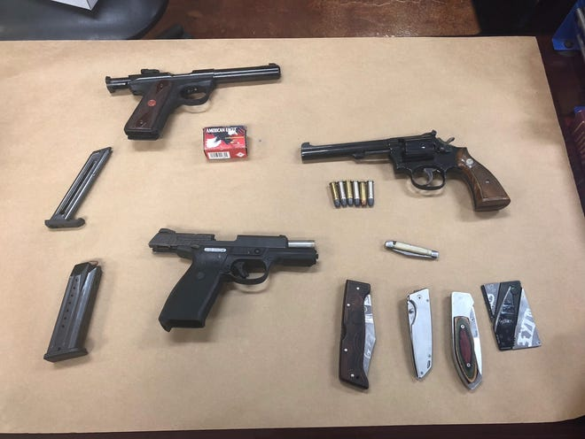 Healy was found to be in possession of three handguns.