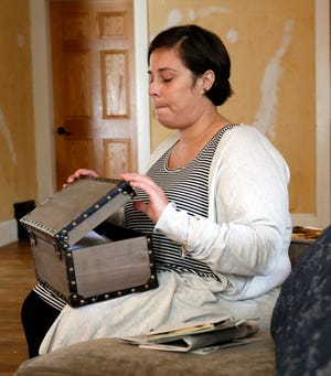 Krista Price closes a box containing letter's and cards she received after her daughter Kherington Brownell died in a car crash in Wisconsin.