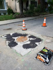 After three weeks of waiting for MSD to finish a manhole replacement in front of his house, Shawn Reilly went to work.