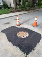 The manhole in front of Shawn Reilly's home in the Highlands after he took matters into his own hands and finished the job MSD started weeks earlier.
