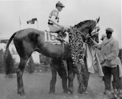 "Jockey Don Meade on Brokers Tip following the ""fighting finish"" of the 1933 Kentucky Derby."