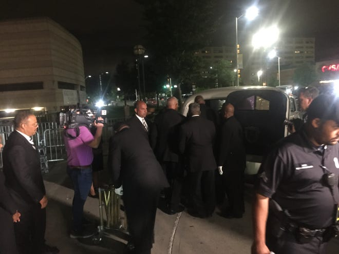 Aretha Franklin's casket is placed into a hearse following Wednesday's visitation at the Charles H. Wright Museum of African American History in Detroit.