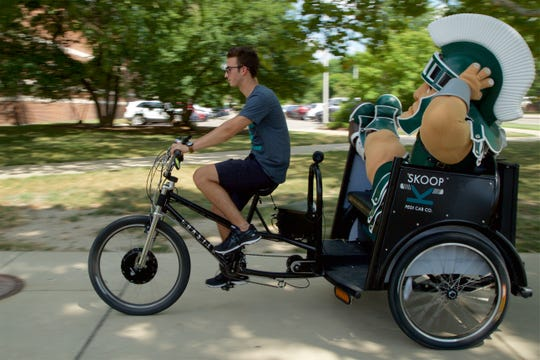 An East Lansing-based company called Skoop offers free rides around MSU's campus. Employees are expected to give rides on football game days.