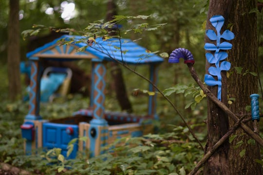 """Part of """"The Blue Loop,"""" a 1,000-foot art installation on Bath Township artist Robert Park's property, as seen Thursday, Aug. 30, 2018.   In May, the township ordered him to clean up his property, including removal of the installation he's worked on for over two years.  Officials say it's """"junk,"""" to him, it is art.  A hearing is set for Oct. 31 in Clinton County District Court where a judge will determine if his installation violates the anti-junk ordinance."""