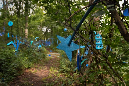 """""""The Blue Loop,"""" a 1,000-foot art installation on Bath Township artist Robert Park's property, as seen Thursday, Aug. 30, 2018.   In May, the township ordered him to clean up his property, including removal of the installation he's worked on for over two years.  Officials say it's """"junk,"""" to him, it is art.  A hearing is set for Oct. 31 in Clinton County District Court where a judge will determine if his installation violates the anti-junk ordinance."""