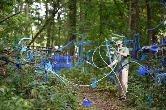 The Blue Loop, a 1,000-foot art installation on Bath Township artist Robert Park's property, as seen Thursday, Aug. 30, 2018.