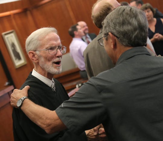 Judge James DeWeese was congratulated for his 28 years of service in the Richland County Common Pleas court by friends and family members during a reception.