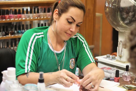 Melissa Rodriquez does a client's nails at the State Beauty Academy. She graduated from the school Aug. 24, the last day the school was open. It has been sold to the Ohio State School of Cosmetology, which will open a beauty school at the same downtown location in the coming weeks.